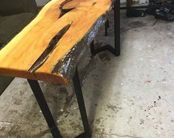 Juniper live edge sofa table with an epoxy finish.