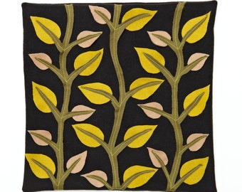 Leaves Alone wool felt cushion cover with appliqued and embroidered leaves and branches