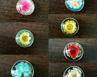 Button pressure for interchangeable jewelry