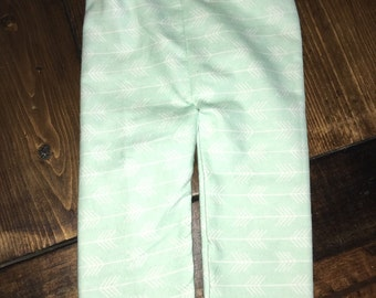 Mint and white arrow pants