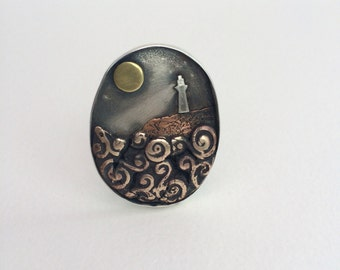 Silver and mixed metal lighthouse  Brooch; 'When you lose your way'