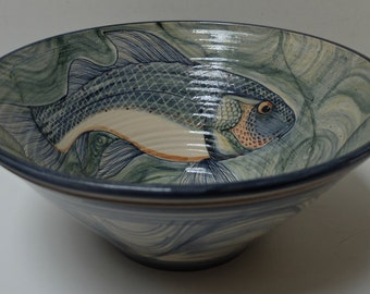 Fish decorated pottery bowl