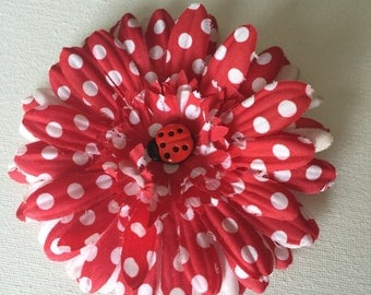 Red and white polka dot daisy flower with ladybug center hair clip