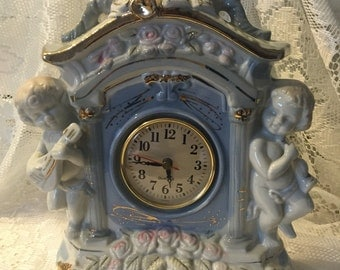 Vintage Porcelain Cherub Mantle Clock-With Beautiful White Doves, Muted shades of Blue, Pink, Green with Gold Gilt