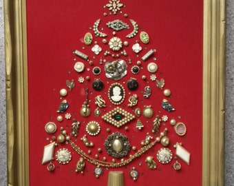 Framed Folk Art Jewelry Collage, made of 1930's and 1940's jewelry arranged in a Christmas tree design