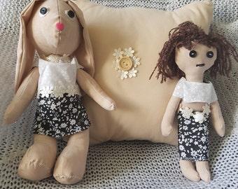 Handmade rag doll rabbit with her matching rag doll friend