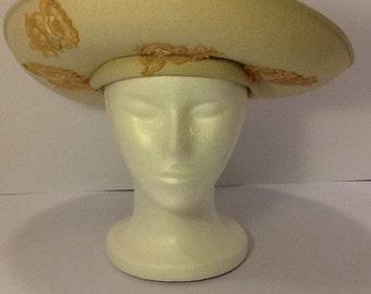 Cream (ecru) brimmed vintage hat with flower appliqués.