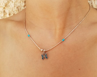 925 silver butterfly decorated with four blue gemstones