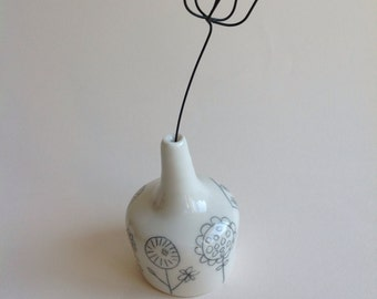 Small porcelain vase with porcelain seed pod
