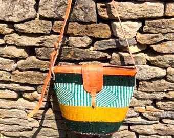African 100% wool, cow hide leather bag with zip. Bright, vibrant and exciting!