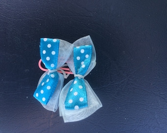 Dark blue polka dot dog bow