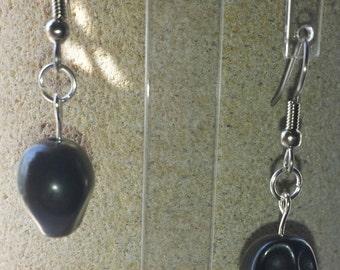 Black turquoise carved skull earrings