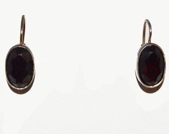 Sterling silver earrings with red stones