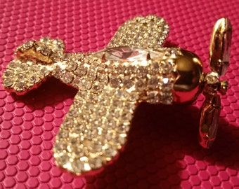 Dorothy Bauer spinning propeller rhinestone encrusted vintage goldtone airplaine pin