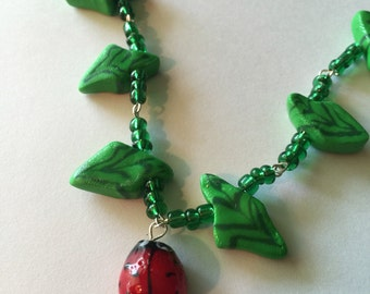 Green Millifiori Polymer Clay Leaf Necklace with Glass Ladybug Charm and Glass Beads