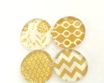 Set of four glass magnets