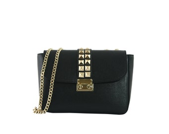 Black leather shoulder bag with studs and lock fastening