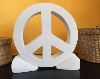 Sculpture figure symbol of the peace carved by hand of plaster, list for paint, mold.