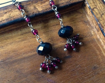Sterling silver garnet and onyx drop earrings. Post earrings