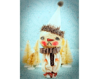 An original Snowman art doll created by Danita Art from a recycled plastic toy, using spun cotton for the head and a handmade clown suit