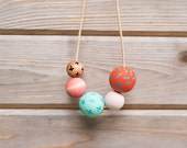 Hand Painted Wooden Bead Necklace in Pool Party,  Anna Joyce, Portland, OR.
