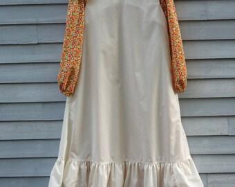 Girl, size 10/12, Pioneer costume, orange and cream.