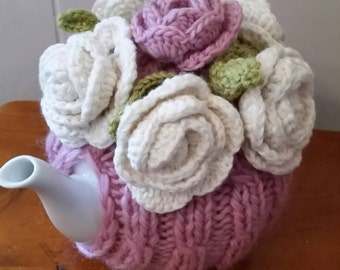 Hand knitted tea cosy in awesome soft pink and white. ( tea pot is not included)