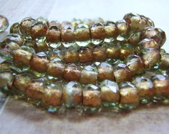 Olive Green Beads Copper Lined 6 x 9 mm Faceted Glass Roller Beads Large Hole 10 Beads