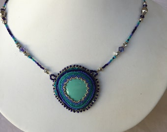 Turquoise beaded necklace with ultra suede