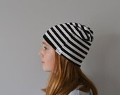 Slouchy reversible black and white striped unisex beanie