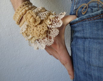 beaded cuff bracelet with hand crocheted laces and beaded flowers in cream and beige tones