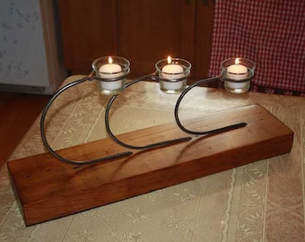 Candle holder with wooden base, blacksmith made votive light circles and curves