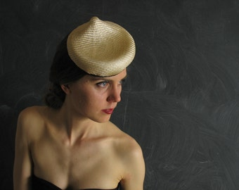 Free Sipping/U.S./Can.-Amuse Tete No.38 a small sculptural and elegant natural parasisol straw cocktail hat.