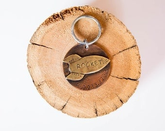 Our dog tags make a unique personalized gift. Each pet id tag is crafted in our Bozeman, Montana studio by dog lovers. Rocket Pet Tag