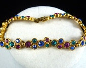vintage crystal bracelet/  Swarovski crystals / jewel colors with gold/ multicolored stones / 1980s style/ costume jewelry /