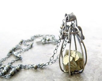 long metalwork necklace, caged silver pendant with pyrite stone, hand fabricated sterling necklace, statement necklace
