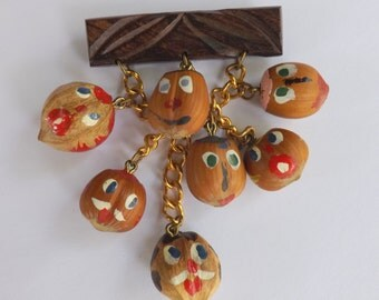 Vintage 1930s 1940s wood and hazelnut painted faces dangle pin or brooch real nuts