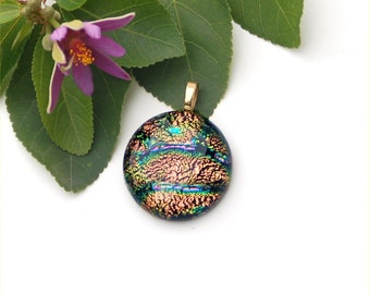 Fused dichroic glass pendant round, in a gold, amber color with veins of green and purple