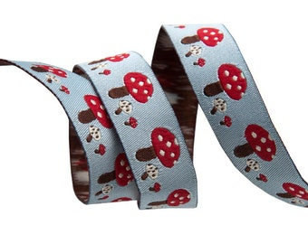 5/8-inch woven jacquard ribbon, red toadstools on blue, adorable design