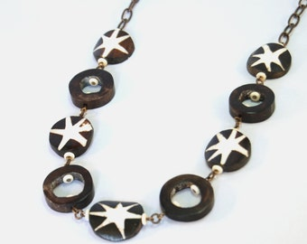 African star brown and white bone necklace by CURRICULUM