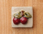 Handmade 2x2 ceramic cherries tile comes with a hanger on the back or ready for a tile installation