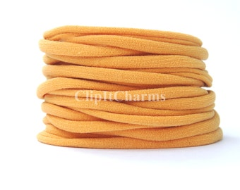 Wholesale .39+ Mango Stretch Nylon Chokers...Use for bottle cap jewelry,pendants,charms, headbands/doubles as a bracelet or anklet.
