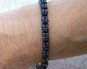 Purple Crystal, Superduo, and Teal Seed Bead Bangle Bracelet by Carol Wilson of Je t'adorn