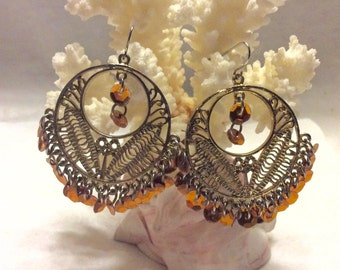 Vintage gold filigree sequens drop dangles earrings.