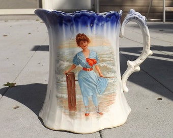 circa 1900 pitcher with pretty lady in swimwear - charity for animals