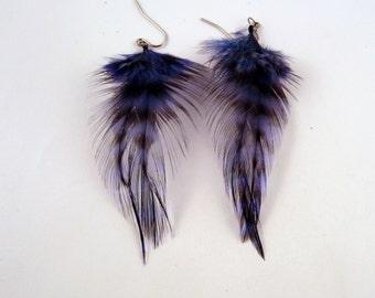 dark Blue dangler feather earrings grizzly