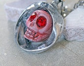 Pink sugar skull, pink day of the dead, pink gothic jewelry, pink Halloween skull necklace, pink sugar skull with red eyes