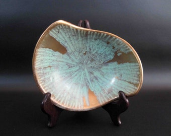 Vintage Mid Century Pottery Bowl in Green and Gold. Circa 1960's.