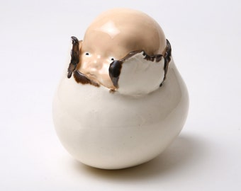 Baby emerging from Egg Sculpture from the Stork delivery service