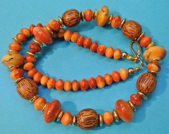 RARE beautiful handcrafted vintage 1970s natural organic orangered apple blossom coral/ brown ape wood bead necklace+ goldcolor spacer beads